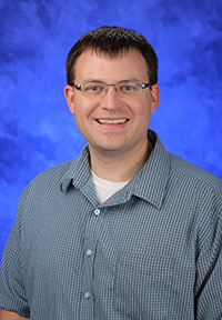 A head-and-shoulders professional photo of Mark Spangler