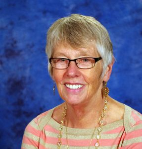 Author photo of Dr. Maryellen Weimer in 2014, an older woman in a striped sweater in front of a blue background.