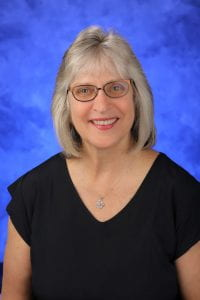 A head-and-shoulders professional photo of Julie Gill