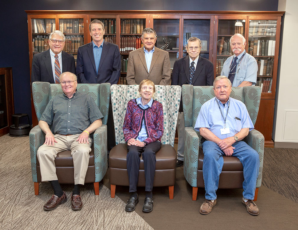 Penn State College of Medicine's Emeritus Faculty Organization officers are seen in June 2019. Three are sitting and five are standing behind them.
